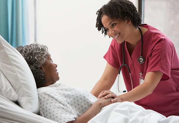 Nurse helping patient image